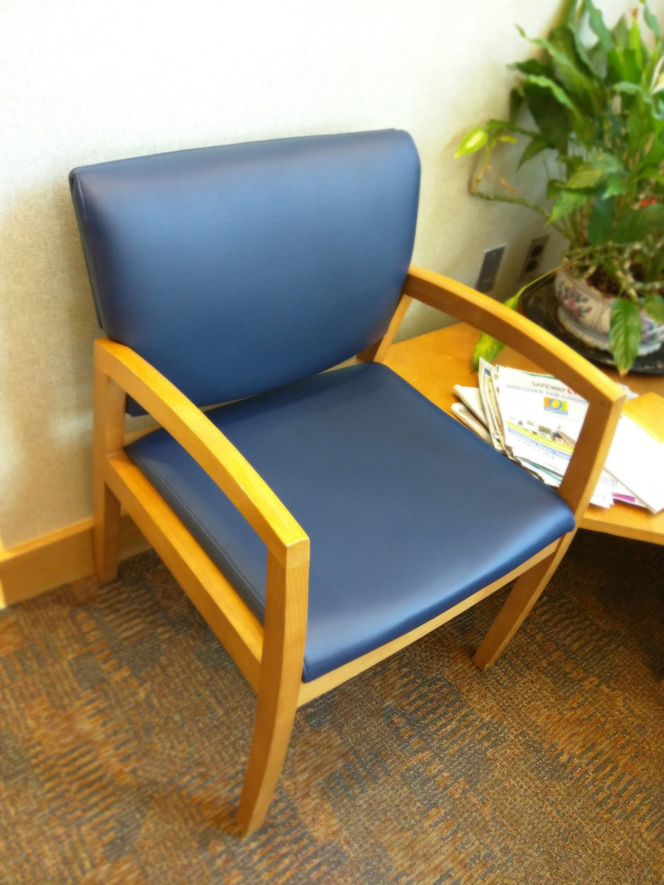 An individual waiting room lobby chair seat, recovered in Olympus Majestic vinyl